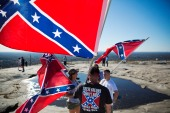 Confederate flag supporters gather at the top of Stone Mountain after hiking up during a 2015 rally [File: David Goldman/AP Photo]