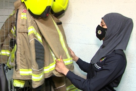 Blazing a trail for women in the fire brigade, Uroosa Arshid is thought to be the UK's first hijab-wearing firefighter. (Al Jazeera)