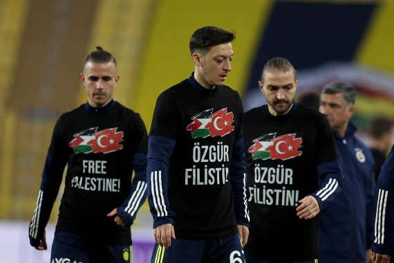 "Players from Turkish side Fenerbahce warmed up for a recent game wearing T-shirts featuring the message ""Free Palestine"" [Ahmet Bolat/Anadolu Agency via Getty Images]"