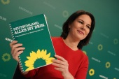 Annalene Baerbock, co-leader of the German Greens Party, holds up a description of the party's policy program at a livestreamed, digital press conference ahead of Germany's federal elections scheduled for September on March 19, 2021 in Berlin, Germany [Sean Gallup/Getty Images]