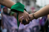 Women take to the streets in Mexico City on International Women's Day on March 8, 2019 with green bandanas, the Latin American Pro-Choice Symbol [ File: Andalusia Knoll Soloff/Al Jazeera]