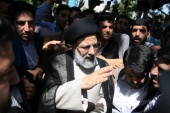 Iranian presidential candidate Ebrahim Raisi enjoys strong backing from a wide range of conservatives and hardliners [TIMA via Reuters]