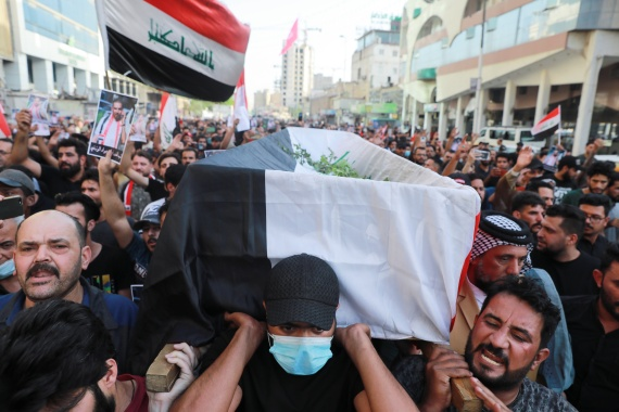 Mourners carry the coffin of Iraqi civil society activist Ihab al-Wazni who was killed by unidentified gunmen in Karbala [Abdullah Dhiaa al-Deen/Reuters]