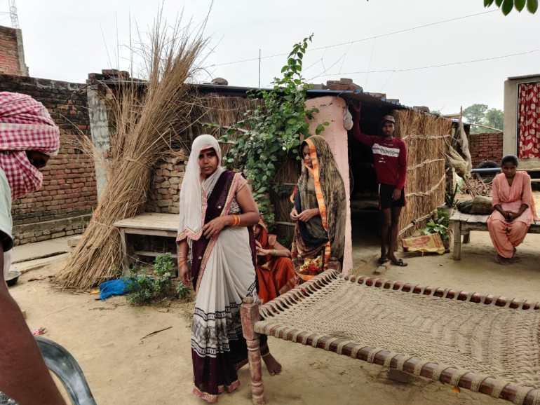 Kavita Devi and other family members outside her house in Gahmar village Ghazipur Uttar Pradesh.