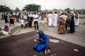 A Muslim worshipper prays to celebrate Eid al-Fitr at the Martyrs' Stadium in Kinshasa [File: John Wessels/AFP]