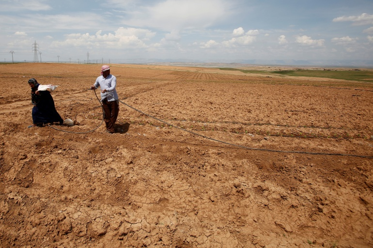 Iraqi farmers work in their fields in northern Iraq's Nineveh Plains [File: Khalid al-Mousily/Reuters]