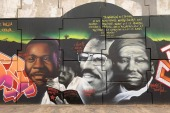 Omar Blondin Diop depicted among other African and African American activists in a mural painted on June 15, 2020 by the Senegalese graffiti collective Radikal Bomb Shot in Dakar [Courtesy of RBS]