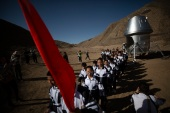 The success of China's space programme, which only began in the 1990s, has fuelled the development of hugely popular space camps where people can get a sense of life on Mars [File: How Hwee Young/EPA]
