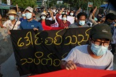Demonstrators march during an anti-military coup protest in Mandalay on Monday [Stringer/EPA]