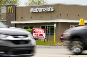 McDonald's is also encouraging its franchises — which make up 95 percent of its restaurant base — to boost pay in the United States [File: Keith Srakocic/AP]