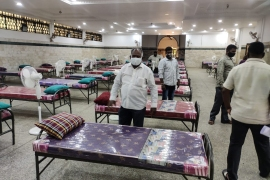 In Jamia mosque in Bengaluru, volunteers stand in the mosque which is now catering to patients affected with the virus. [Courtesy: Mosque committee Bengaluru]