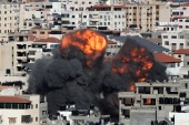 Smoke and flames rise during an Israeli air strike in Gaza City [Mohammed Salem/REUTERS]