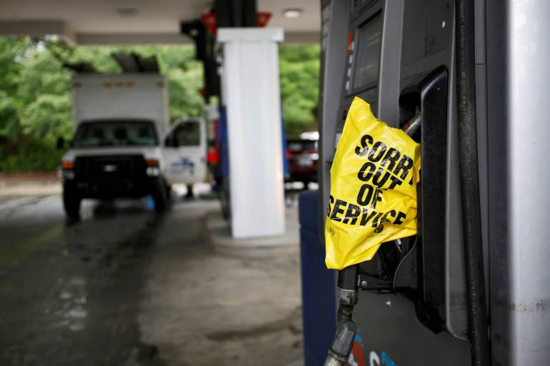 Colonial, which operates the largest fuel pipeline in the United States, became aware of the hack around May 7 and shut down its operations, which led to fuel shortages and lines at gas stations along the East Coast [File: Jonathan Drake/Reuters]