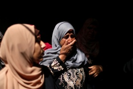 A relative of Palestinian man Ahmed Al-Shenbari, who was killed amid a flare-up of Israeli-Palestinian violence, mourns during his funeral in the northern Gaza Strip May 11, 2021 (REUTERS/Mohammed Salem) (Reuters)