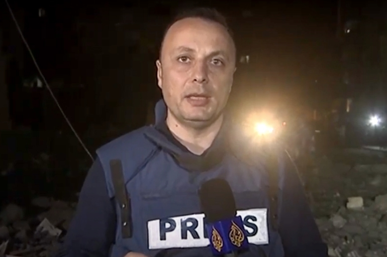 Al Jazeera correspondent Hisham Zaqqout reports from the site of an Israeli air attack in Gaza [Screenshot/Al Jazeera]