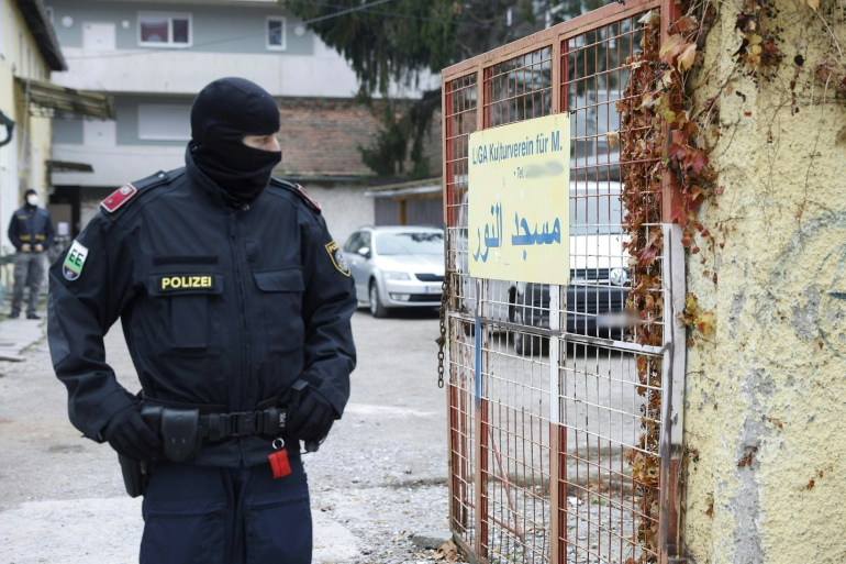 A police officer stands guard in front of a Muslim cultural centre and mosque in Graz which was raided in a police operation on November 9, 2020 [File: AFP/Erwin Scheriau]