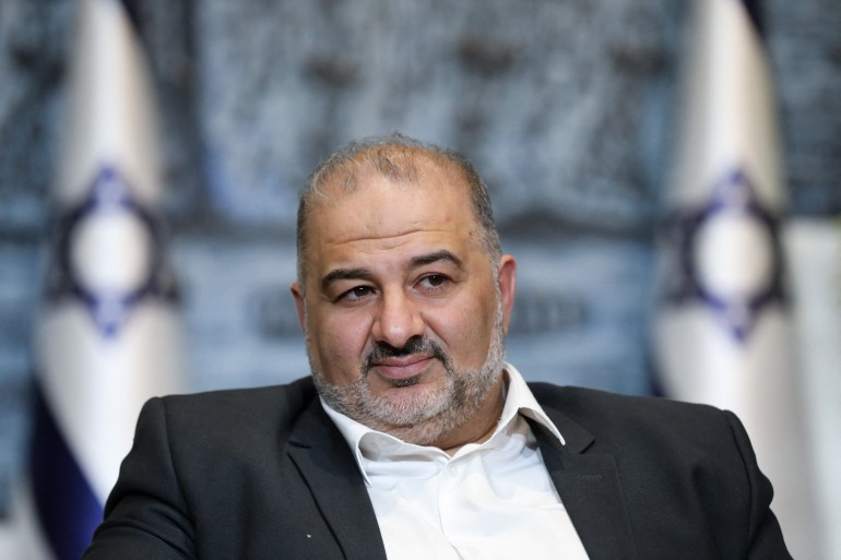 Leader of the United Arab list, Mansour Abbas signed the coalition agreement in the final hours before the deadline [File: Abir Sultan/POOL/ AFP]