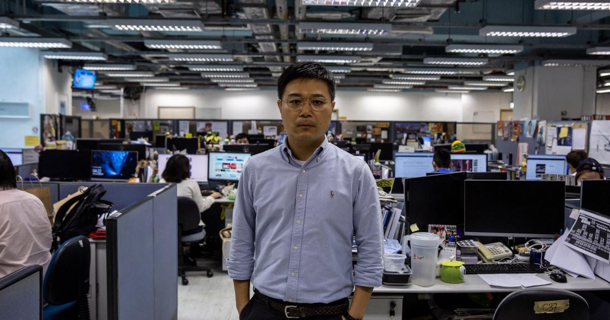 Hong Kong police arrest Apple Daily editor, directors, raid HQ