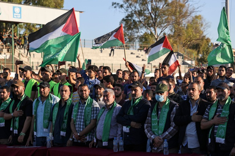 Supporters of Hamas wave flags during a rally in Gaza City on May 24, 2021 [AFP/Mahmud Hams]