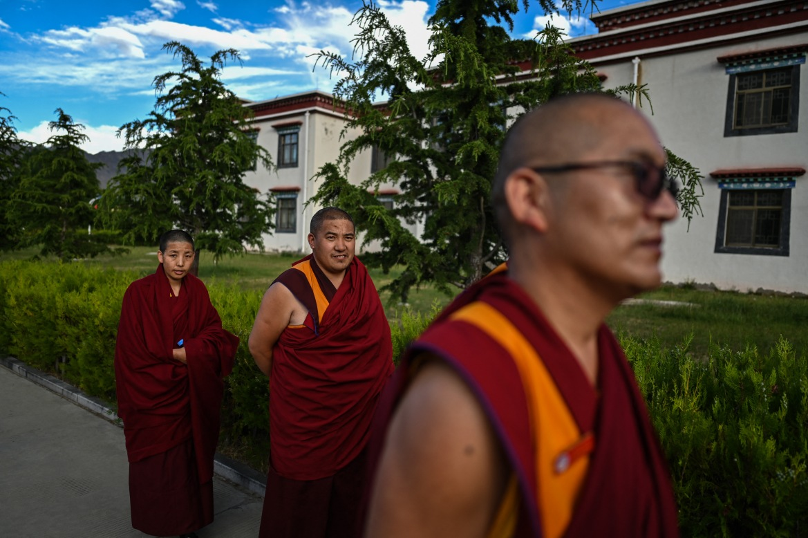 Monks take a walk after class at the Tibet Autonomous Region Buddhist College. Since 2008, it has been nearly impossible for journalists to visit Tibet except on organised trips. [Hector Retamal/AFP]