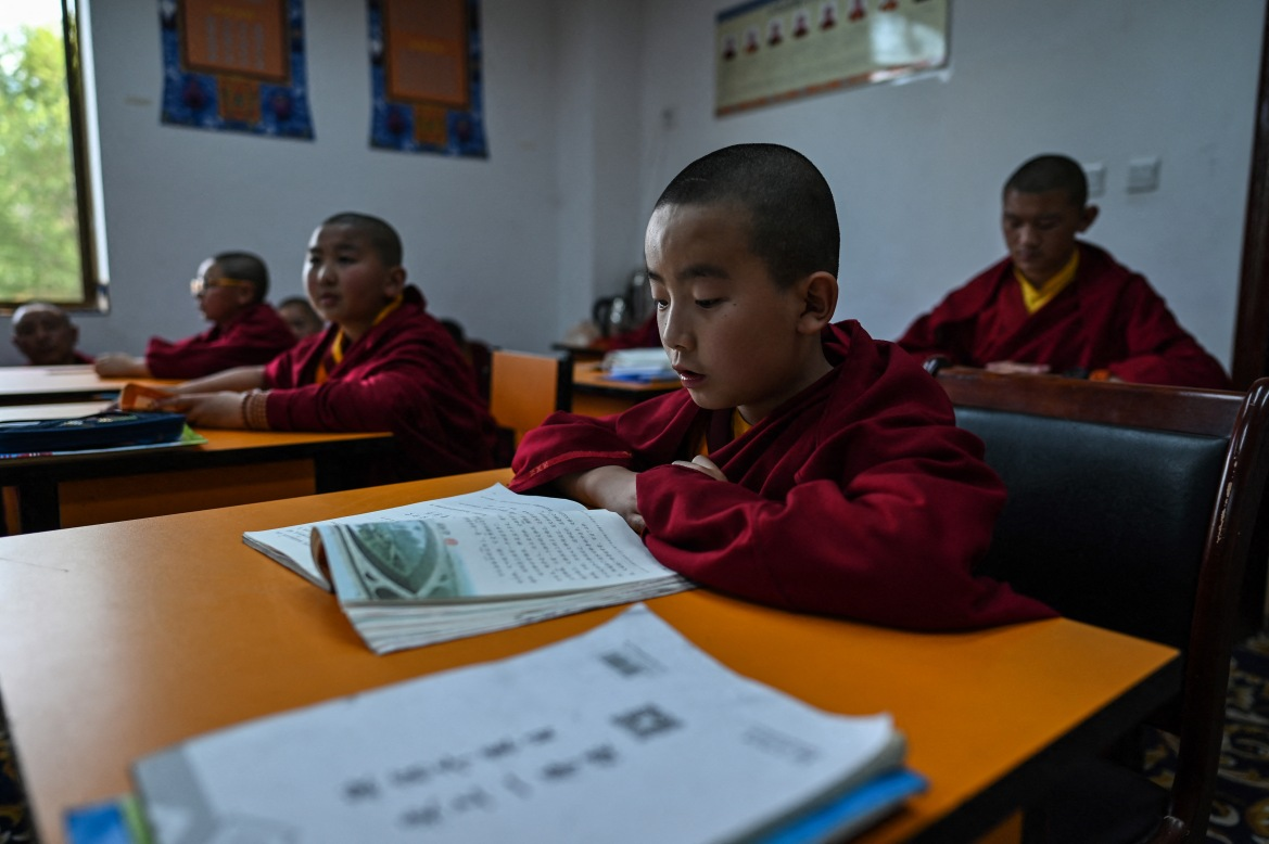 Young monks studying at the Tibet Autonomous Region Buddhist College. Academics say it has become extremely difficult to carry out studies of the region, making it harder to independently assess the quality of life on the ground. [Hector Retamal/AFP]