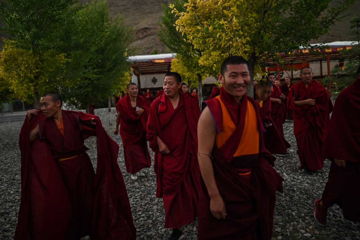 Monks at the Tibet Autonomous Region Buddhist College. The vice president of the university, Gesang Wangdui, told media the college's success is down to China. [Hector Retamal/AFP]