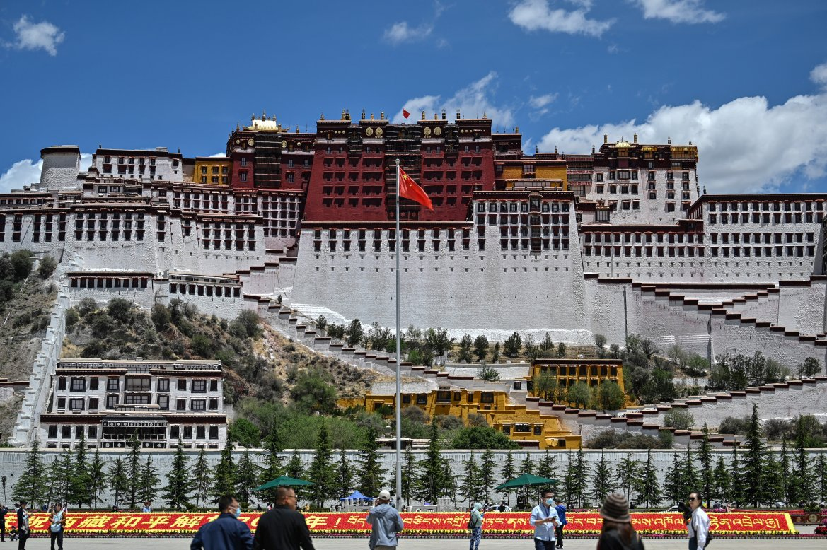"""The Potala Palace - classified as a World Heritage site by UNESCO in 1994 - in the regional capital, Lhasa. Beijing says it """"peacefully liberated"""" the mountainous region of Tibet in 1951 and insists it has since brought infrastructure and education to a previously underdeveloped region. [Hector Retamal/AFP]"""