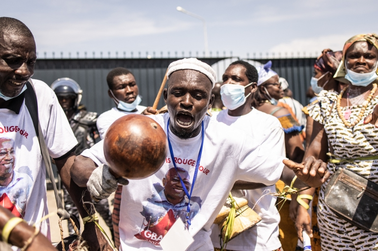 Gbagbo supporters sing and dance ahead of his arrival in Abidjan [John Wessels/AFP]