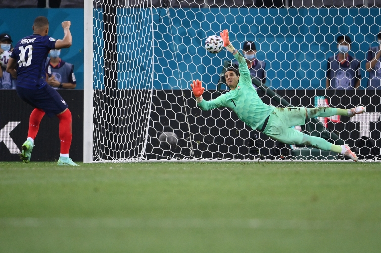 Switzerland's goalkeeper Yann Sommer saves a penalty by France's forward Kylian Mbappe during their Euro 2020 round of 16 football match on June 28 [Franck Fife/Pool via AFP]