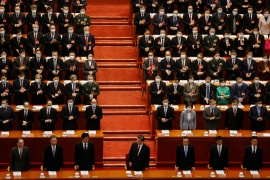 Chinese President Xi Jinping (C) arrives for the closing session of the Chinese People's Political Consultative Conference (CPPCC) at the Great Hall of the People in Beijing, China on March 10, 2021 [File: Carlos Garcia Rawlins/ Reuters]