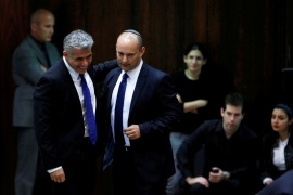 Yair Lapid, second left, and Naftali Bennett, next to him, in the Knesset [File: Baz Ratner/Reuters]