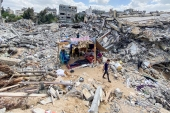 Israeli strikes destroyed at least 2,000 housing units and damaged more than 15,000 others in Gaza during the 11-day attack [Mohammed Salem/Reuters]