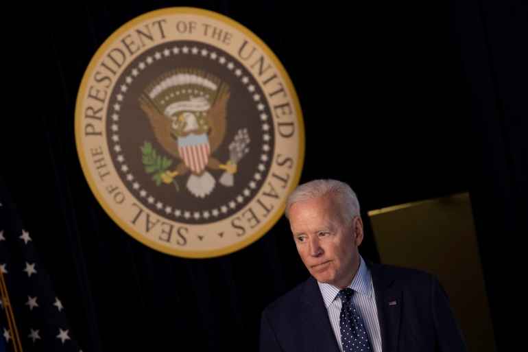 President Joe Biden said the US would share vaccines with the world without expectations for political favours in return [File: Carlos Barria/Reuters]