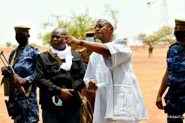 Burkina Faso's Prime Minister Christophe Joseph Marie Dabire gestures during a visit at the site of the attack in the village of Solhan, [Burkina Faso Prime Minister's Press Service/Handout via Reuters]