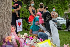 People gathered at the makeshift memorial set up near the scene where a man driving a pick-up truck ran over a Muslim family in what police say was a deliberately targeted Islamophobic attack, in London, Ontario, Canada [Carlos Osorio/Reuters]