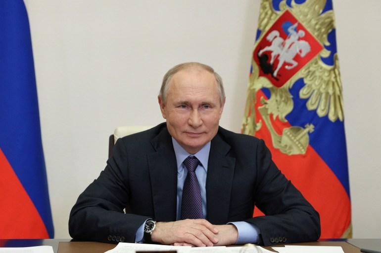Russian President Vladimir Putin weighed in on US President Joe Biden and Biden's predecessor, Donald Trump, in a US TV interview [Sputnik/Sergei Ilyin/Kremlin via Reuters]