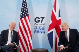 US President Joe Biden laughs while speaking with UK Prime Minister Boris Johnson during their meeting, before the G7 summit [Kevin Lamarque/Reuters]