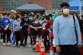 People lining up for vaccine shots in Chelsea, Massachusetts [Brian Snyder/Reuters]