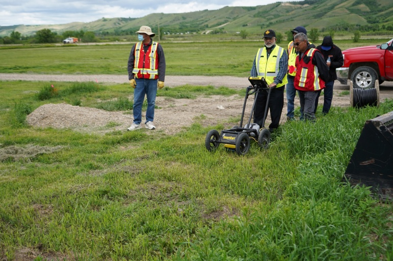 A crew performs a ground-penetrating radar search of a field, where the Cowessess First Nation said they had found 751 unmarked graves, near the former Marieval Indian Residential School in Grayson, Saskatchewan, Canada [Federation of Sovereign Indigenous Nations/Handout via Reuters]