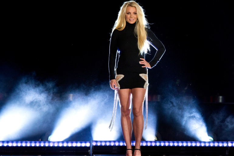 Singer Britney Spears performs in Las Vegas in 2018. She is battling to remove her father from a 13-year legal guardianship that gives him control of her business and personal affairs [File: Steve Marcus/Las Vegas Sun via AP Photo]