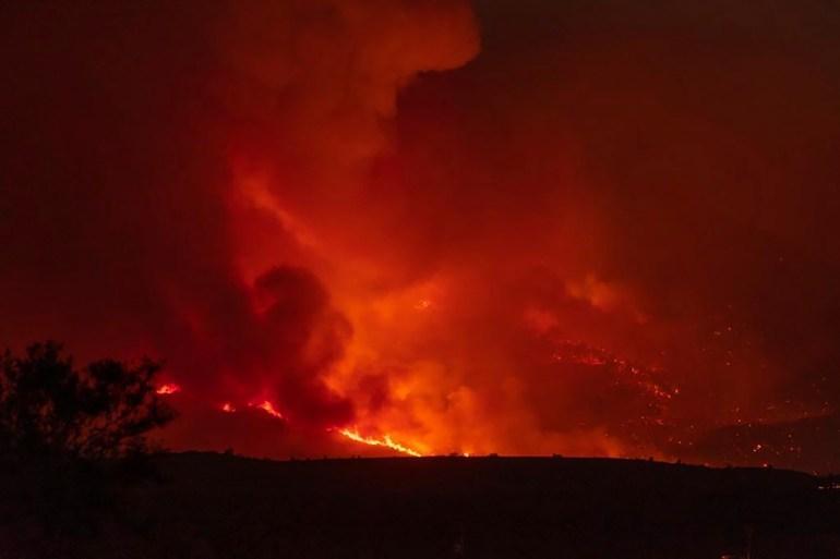 Wildfires burn across US West threatening Flagstaff, Arizona