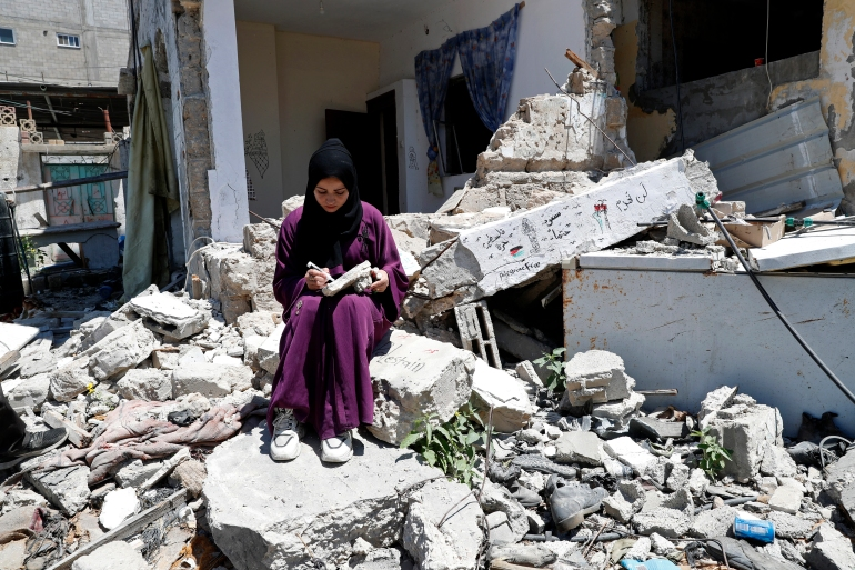 Artist Saja Moussa draws on broken tiles from her family's damaged house in Rafah refugee camp, southern Gaza Strip [File: Adel Hana/AP Photo]