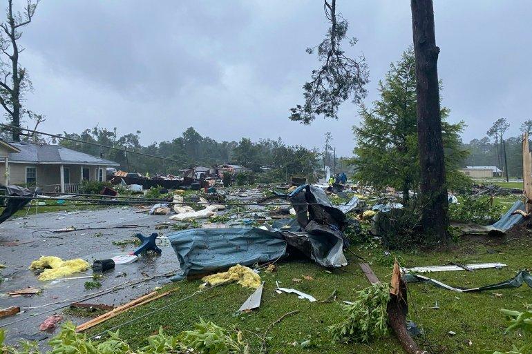 Debris covering the street in East Brewton, Alabama [Alicia Jossey via AP Photo]