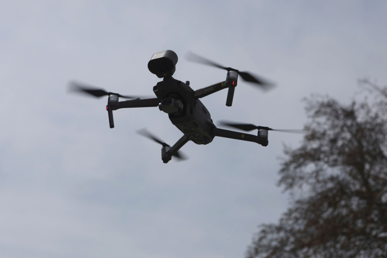 A drone hovers in air to announce COVID restrictions in Indian-administered Kashmir [File: Farooq Khan/EPA]