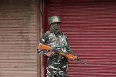 An Indian paramilitary soldier stands guard during lockdown in Srinagar, Indian-administered Kashmir [File: Farooq Khan/EPA]