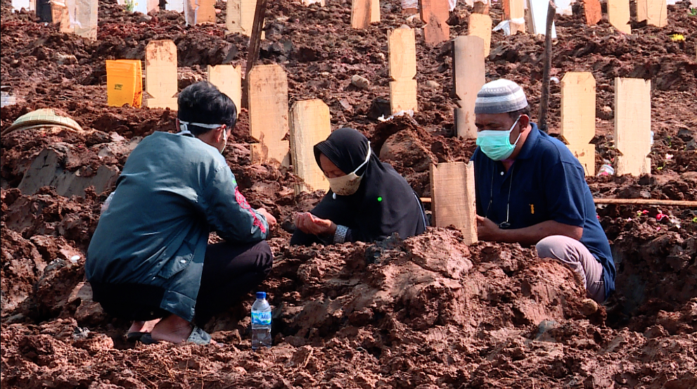 'Suddenly, she's gone': Mud and death in COVID-hit Indonesia