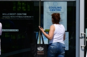 People enter the Hillcrest Community Centre where they can cool off during the extreme hot weather in Vancouver, British Columbia, Canada, June 30, 2021 [Don MacKinnon/ AFP]