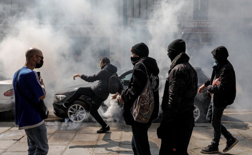 French police fireplace tear fuel as anti-vaccine protest turns violent