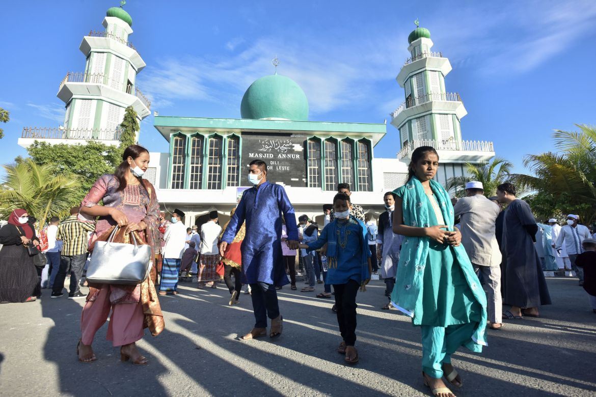 Muslims leave after attending prayers at the Kampun Alor Mosque in Dili, Timor-Leste to mark Eid al-Adha, the annual celebration known as the