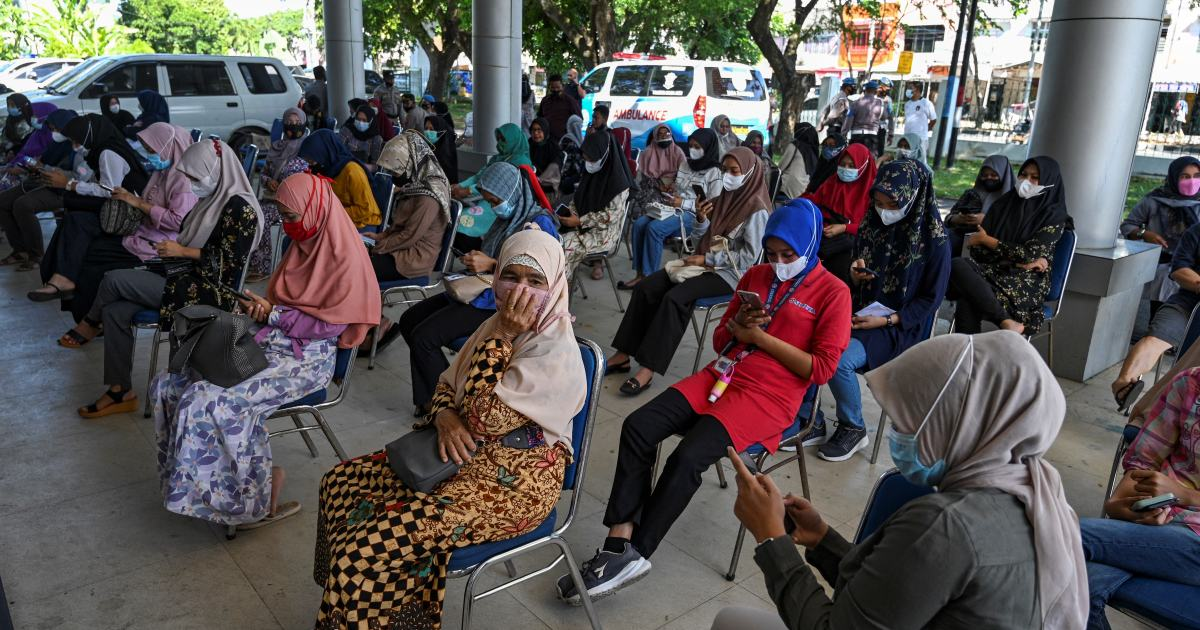 Indonesia extends COVID curbs by a week as hospitals deluged